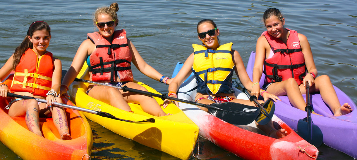 Go on a kayak trip across Lake LBJ with your whole cabin!