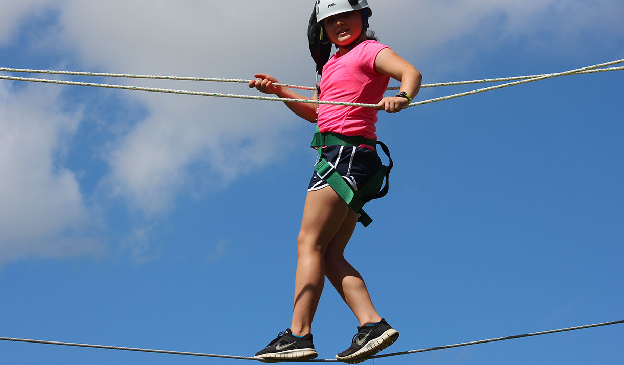 Campers learn to trust in their own abilities high above the Camp Champions property.