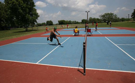 Brian K. Diggs/AMERICAN-STATESMAN  A group of boys plays pickleball (a combination of ping pong, tennis and badminton) on a court at Camp Champions in Marble Falls.
