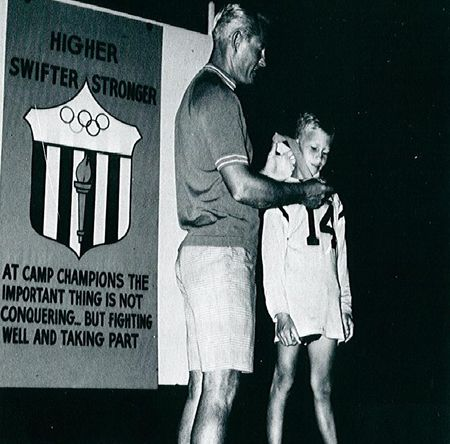 Torchlighter getting medal at Torchlight ceremony at Camp Champions '67.