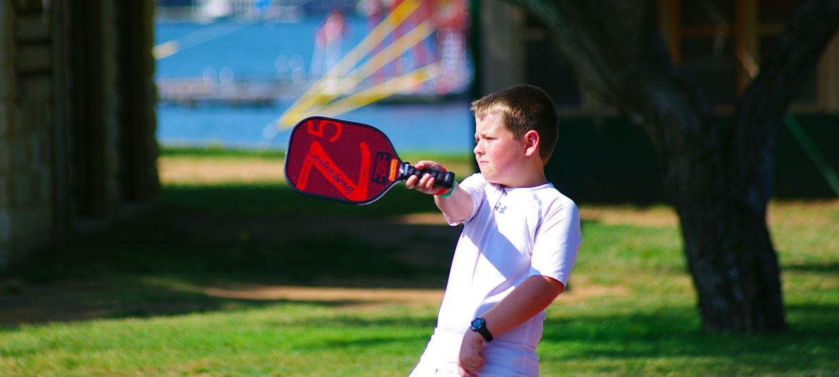 Never heard of Pickleball? It's kind of like a cross between ping-pong and tennis. Crazy, huh? Only at Camp Champions.