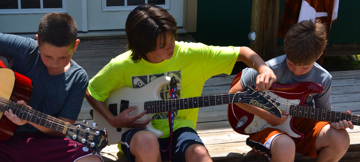 You can play guitar, drums, and more at Camp Champions.